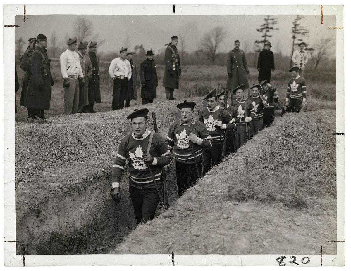 Unknown photographer for the Alexandra Studio. Distributed by the Star Newspaper Service and Times Wide World, Untitled [Members of the Toronto Maple Leaf hockey team in the trenches during a military training session], 1939, gelatin silver print. Photo courtesy of the Rudolph P. Bratty Family Collection, Ryerson Image Centre.