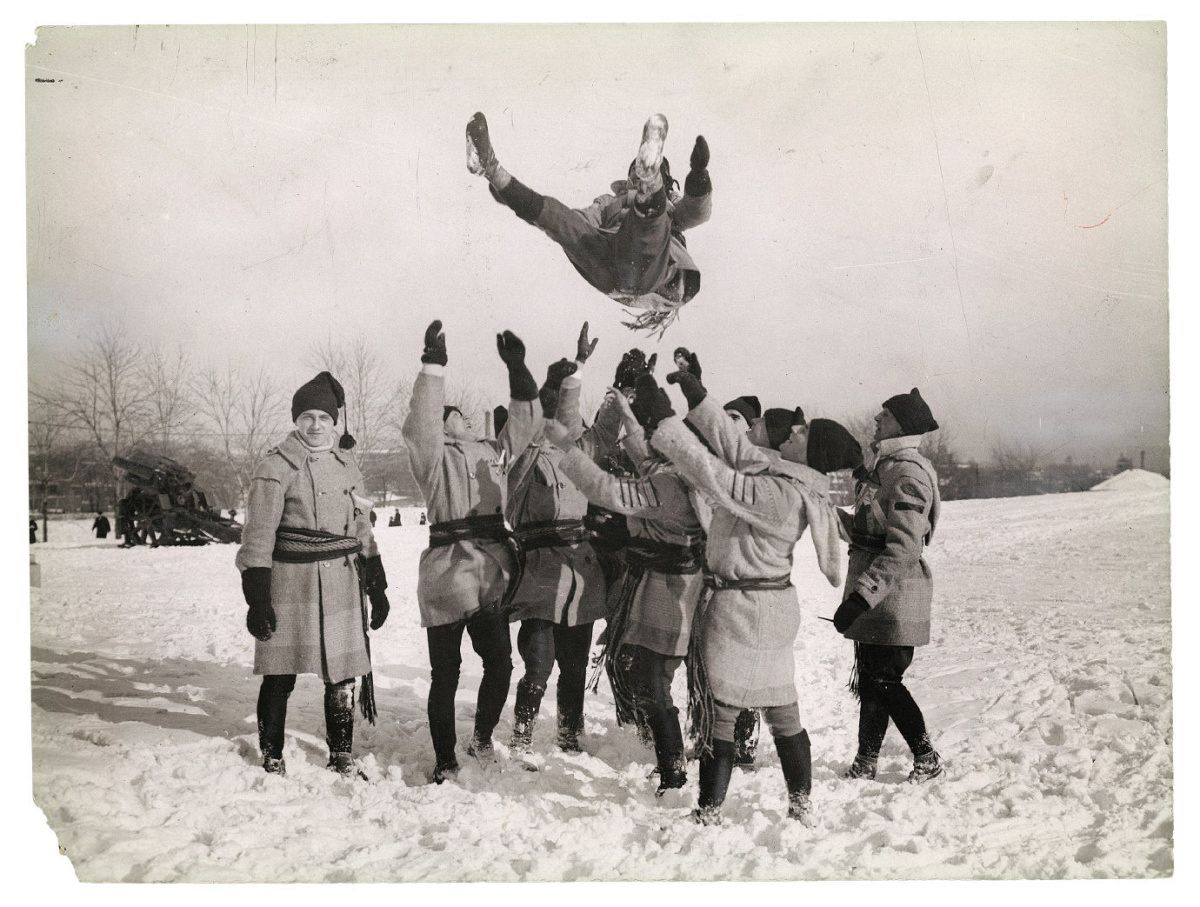 "Unknown photographer for Chesterfield & Maclaren, Untitled [Members of snow-­shoeing club initiating a new member by means of the ""Montreal Bounce,"" Montreal, Quebec], ca. 1924, gelatin silver print. Photo courtesy of the Rudolph P. Bratty Family Collection, Ryerson Image Centre."