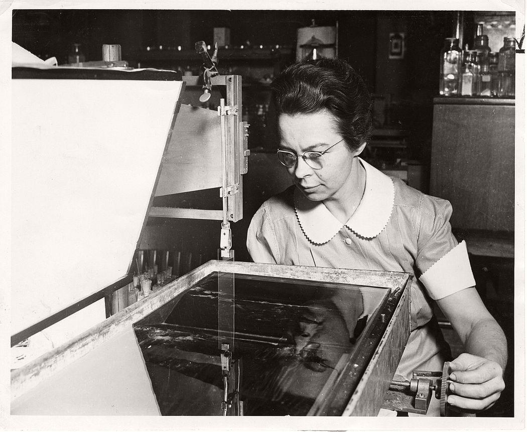 Physicist Katharine Burr Blodgett (1898-1979) demonstrating equipment in lab, 1938