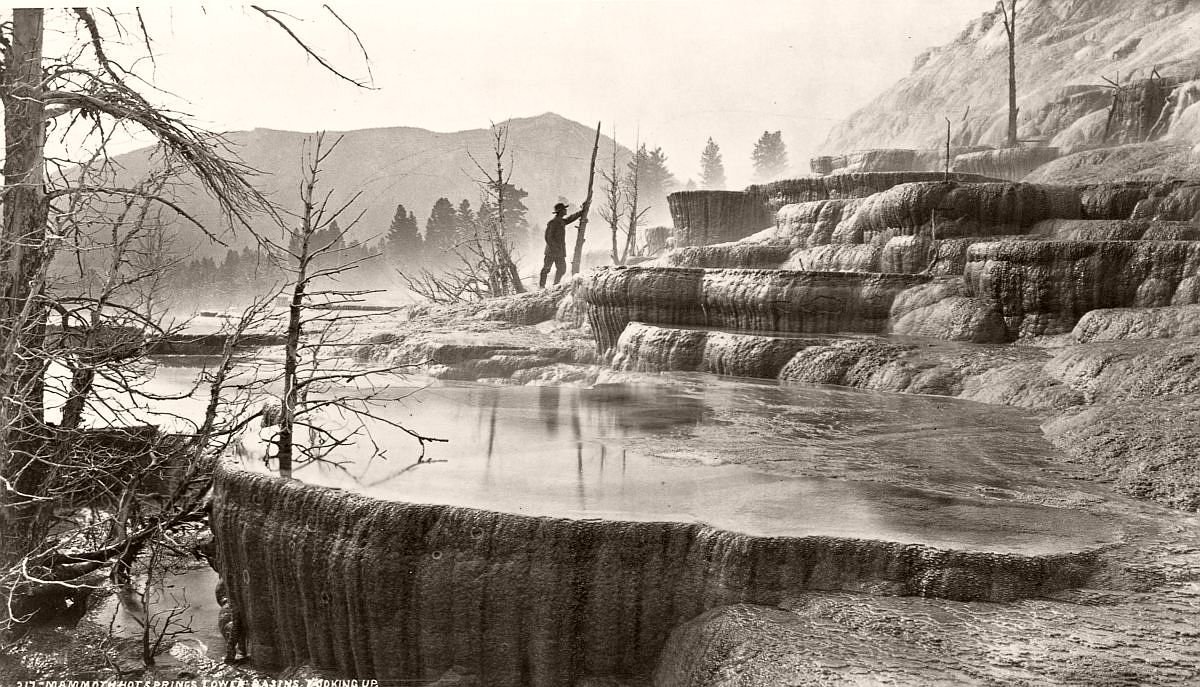 A geological surveyor explores the lower basin of Mammoth Hot Springs in Yellowstone, c.1870. (William Henry Jackson/Library of Congress/Corbis/VCG via Getty Images)