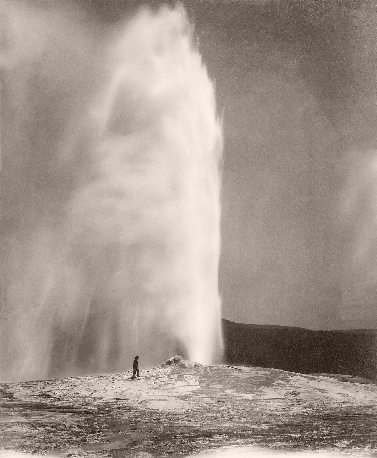A member of a government geological survey stands next to Old Faithful in Yellowstone, two years before its designation as a National Park, 1870. (GraphicaArtis/Getty Images)