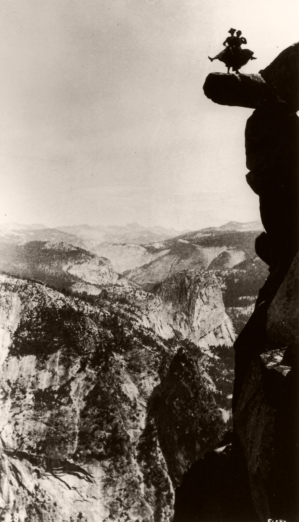 Kitty Tatch and friend dance on the overhanging rock at Glacier Point in Yosemite, c.1890. (Fotosearch/Getty Images)