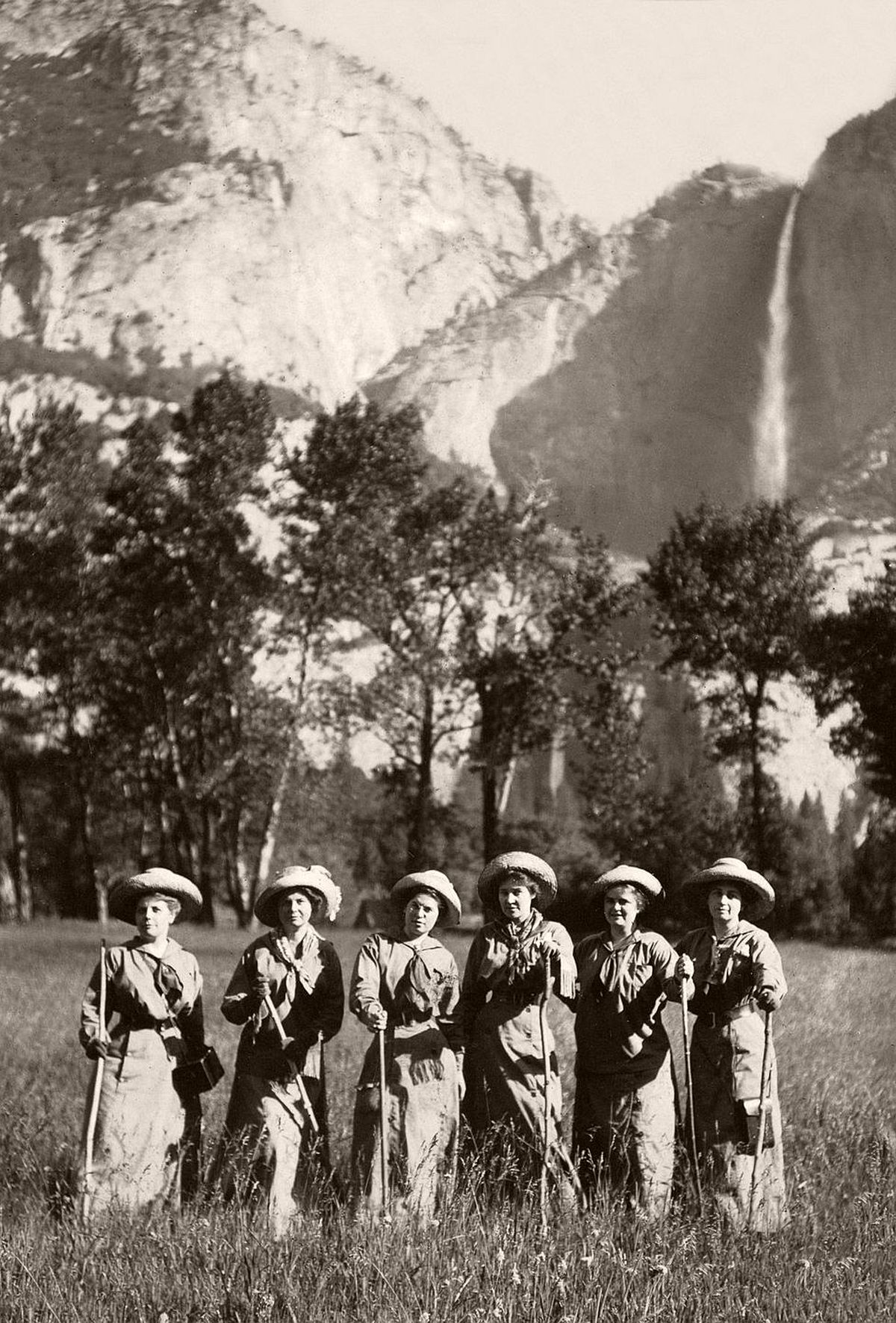 Tourists pose for a picture in front of Yosemite Falls, c.1900. (Jonathan Kirn/Corbis via Getty Images)