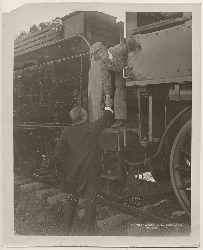 President Theodore Roosevelt shaking hands with a locomotive engineer for the Colorado and Southern Railway. Vernon, Wilbarger County, Texas. April 1905.