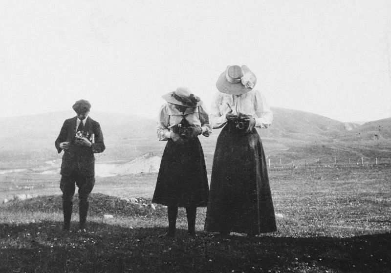 Two women and a man with cameras, 1907. Titled: 'A Henderson, Gladys Younger, J Henderson'.