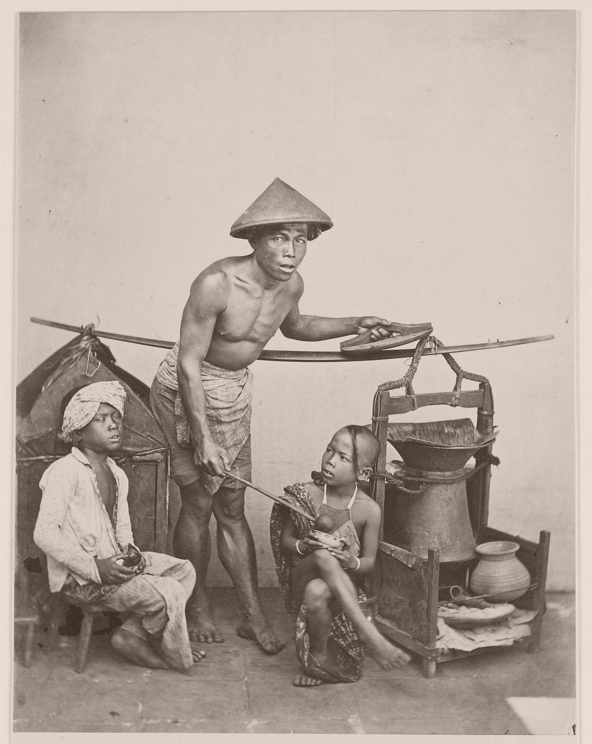 Street vendor in Batavia, circa 1870.
