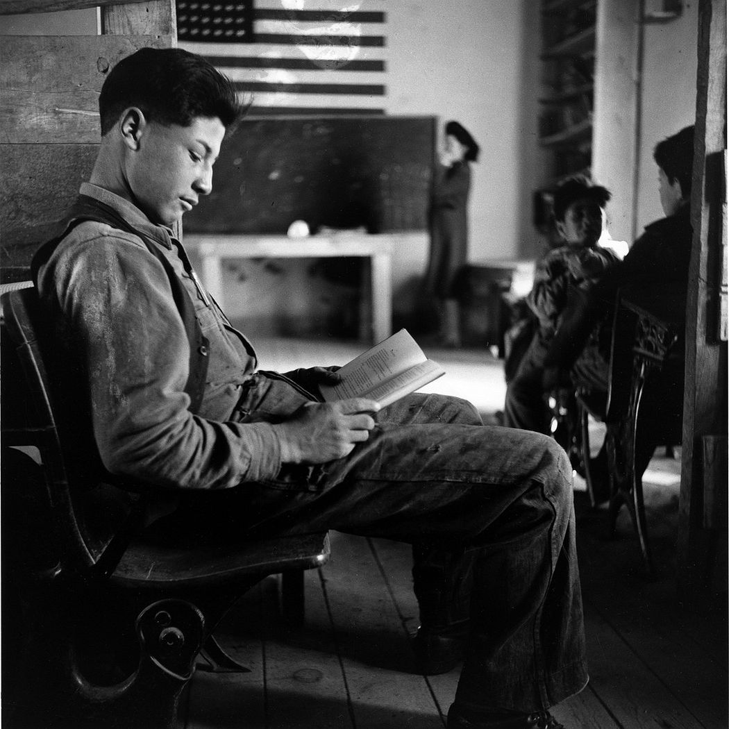 A boy reading in one-room school in an isolated mountainous Hispanic community, Ojo Sarco, New Mexico, 1943