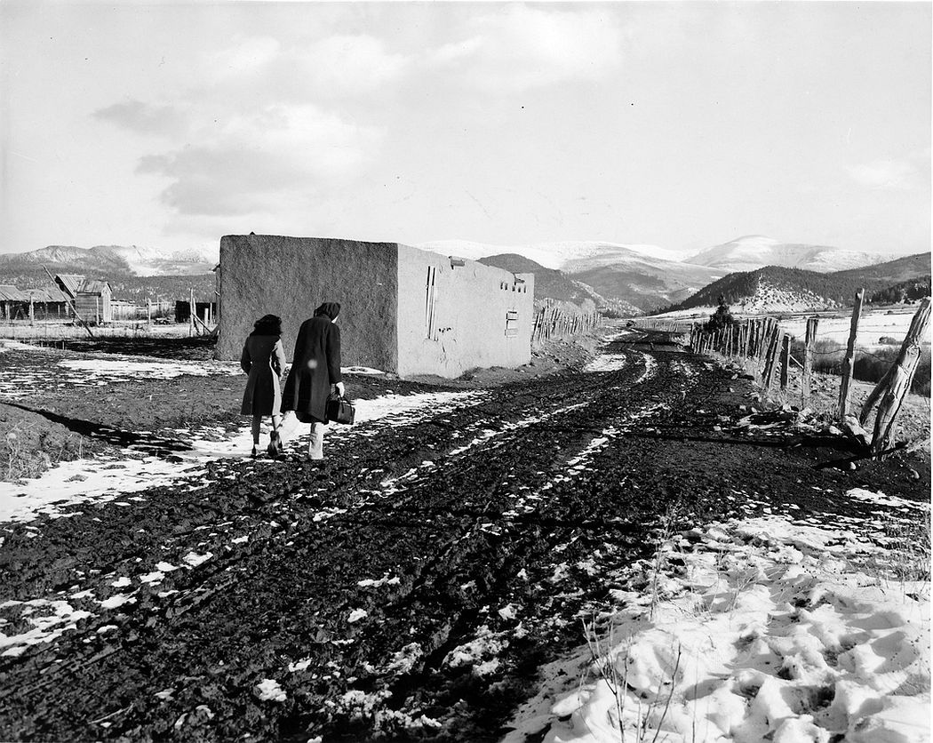 A nurse and an interpreter trying to reach a patient's house beyond passable roads, Llano Quemado, New Mexico 1943