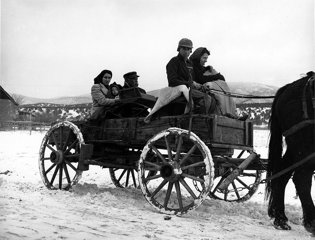 A Hispanic family in their wagon, Peñasco, New Mexico, 1943