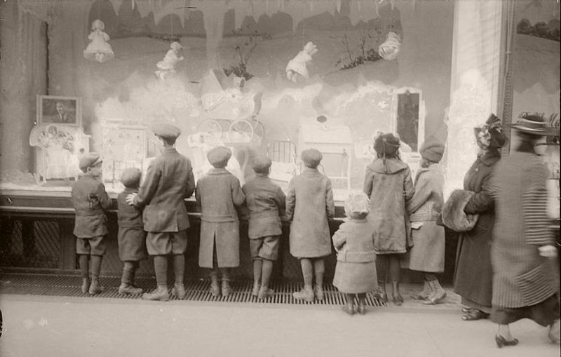 Vintage People Mesmerized By Holiday Windows In New York
