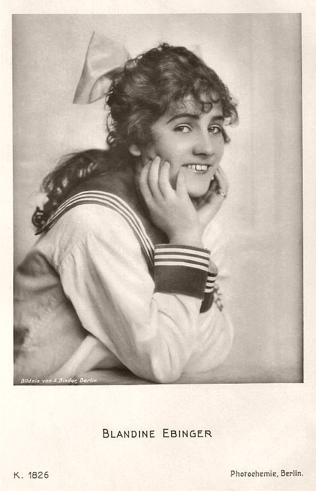 "Blandine Ebinger (1899-1993) was a German cabaret singer and actress. Author Erich Kästner described her as ""This lisping, scrawny person with the big, severe eyes is a master of the tragic-grotesque."" Her cinema career continued for seventy (70!) years. Her more than 90 film roles were once bigger, once smaller, but all her characters distinguished through her impressive acting."
