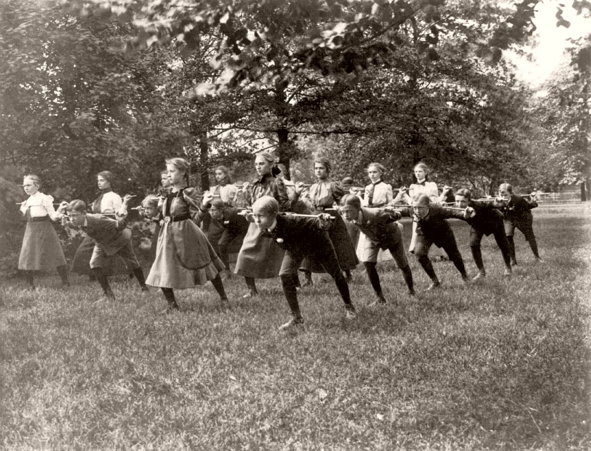 Classroom scenes in Washington, D.C. public schools - outdoor exercise with rods - 3rd Division, ca. 1899
