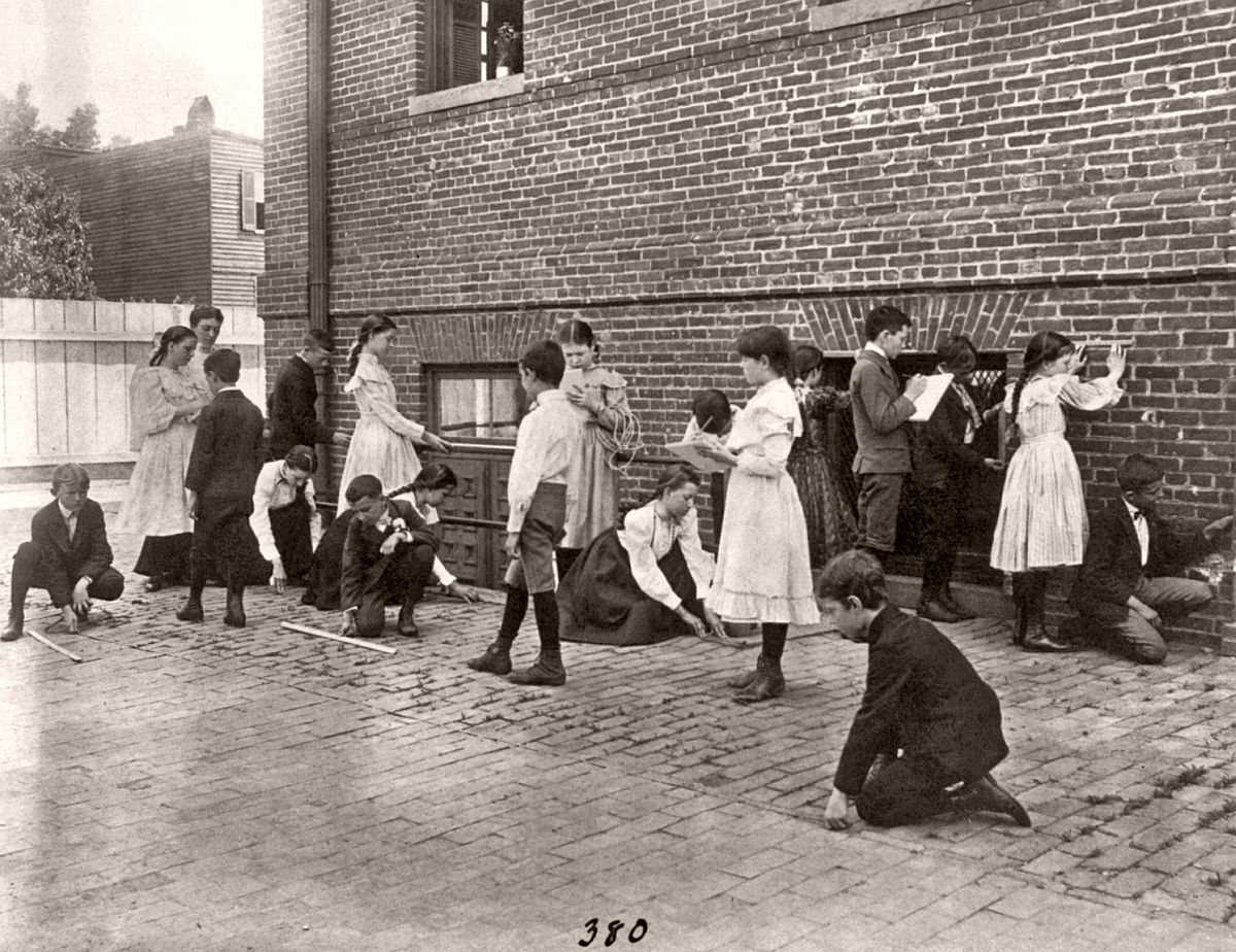 Students of 8th Division school using rulers, yardsticks, and measuring tape in school yard, Washington, DC, ca. 1899