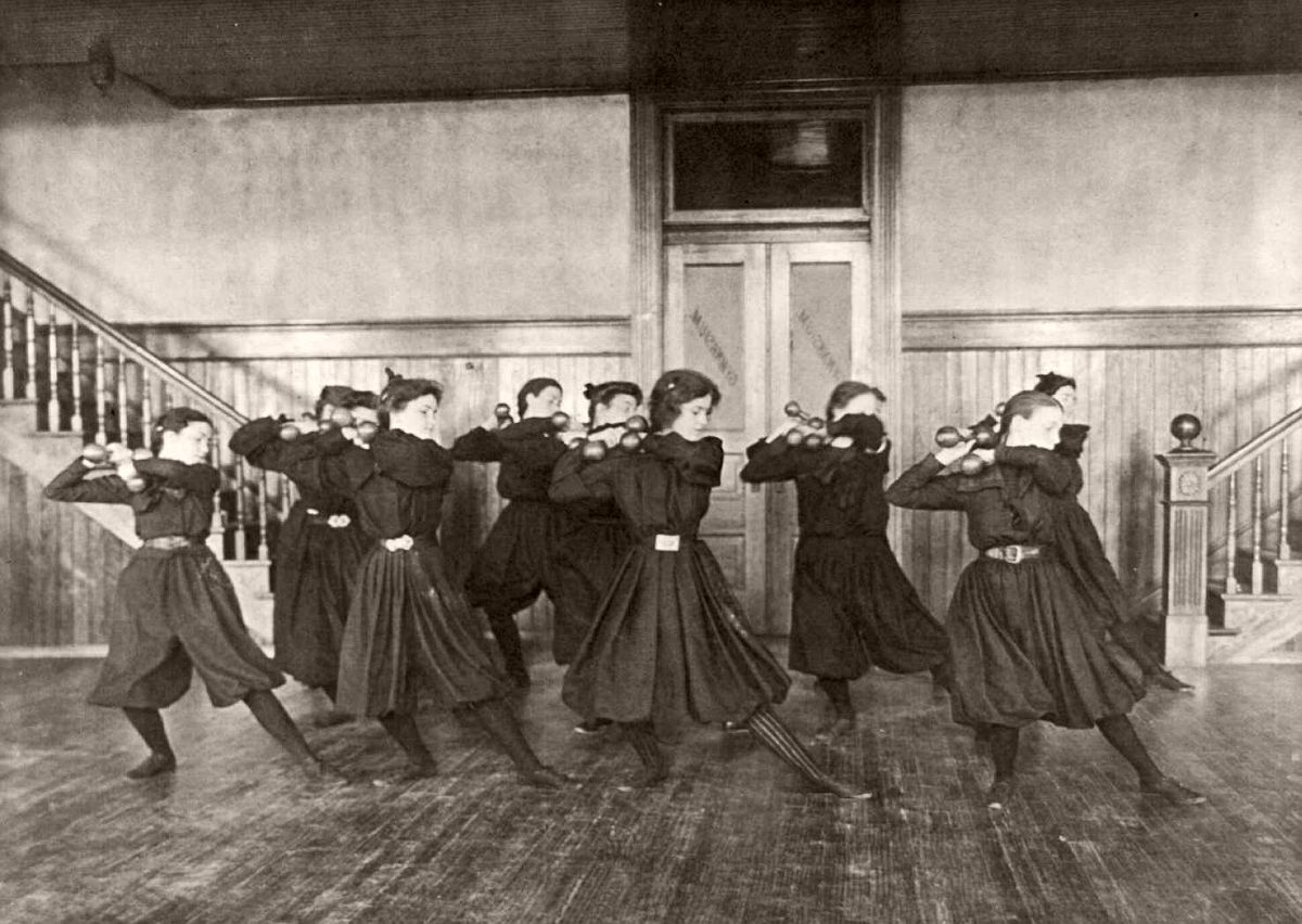 Female students exercising with dumbbells, Western High School, Washington, DC, 1899