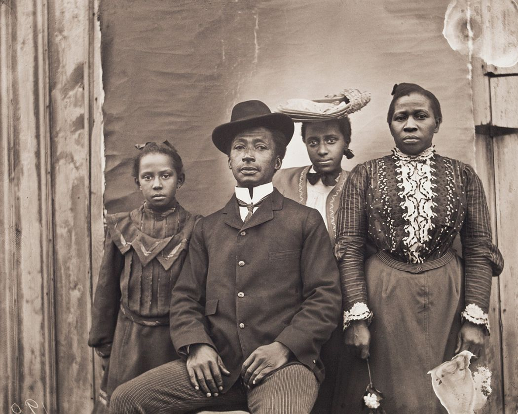 Portrait of James J. and Jennie Bradley Johnson Family,, 1900, printed 2016, archival inkjet print, E.132.16.10 James J. Johnson, of Nipmuc and African American descent, and Charleston, South Carolina, migrant Jennie Bradley, pose with their daughters, Jennie and May (below). James worked as a coachman and belonged to the King David Masonic Lodge. James died soon after this portrait was taken. Jennie later worked as a laundress.