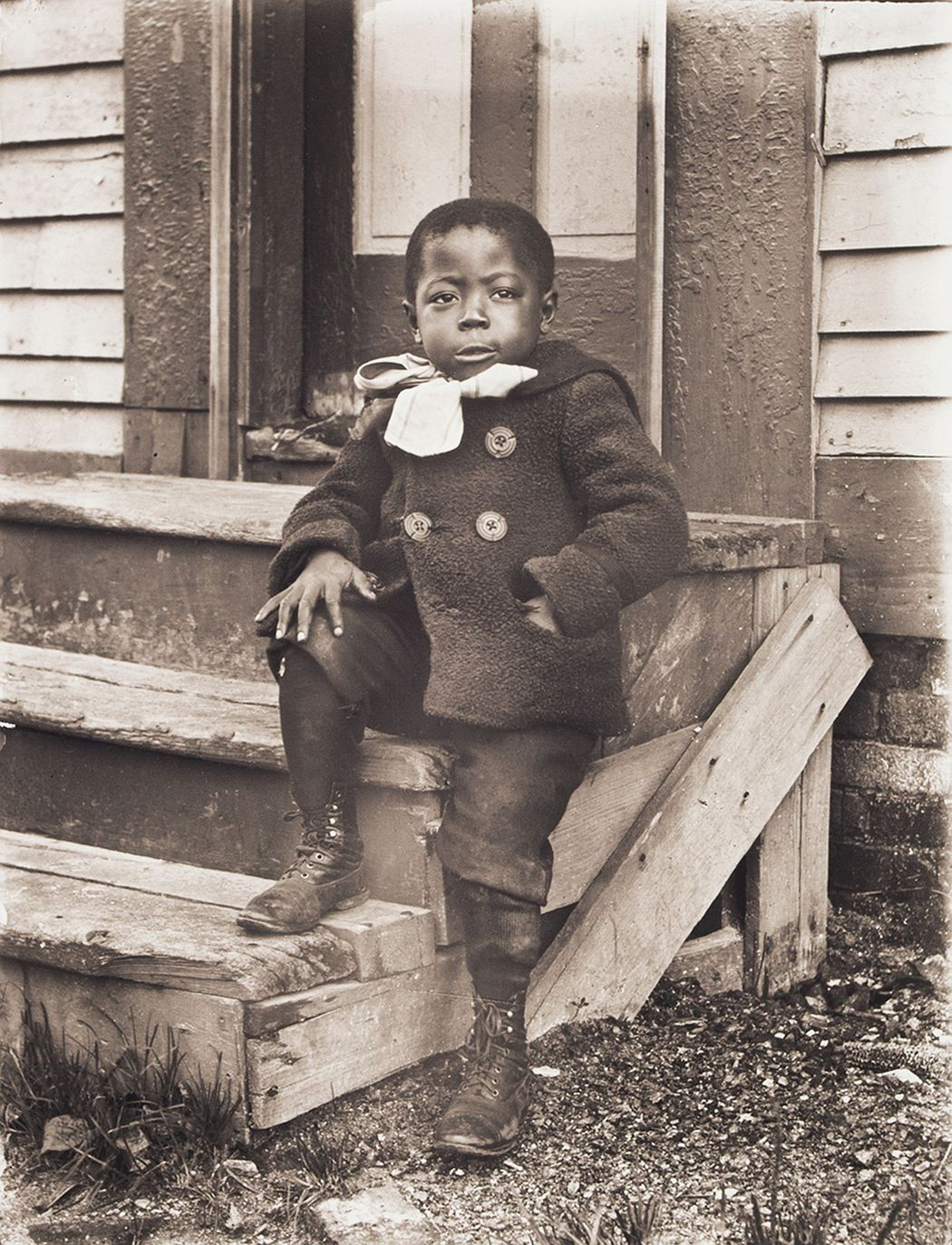 Portrait of Ralph Mendis on a Stoop, about 1902, printed 2016, archival inkjet print, E.132.16.8 Ralph Mendis was born in 1897 and is seen here at approximately age 5. His mother Francis was part of the New Bern, North Carolina, migration of blacks to Worcester, Massachusetts. His father was one of a handful of Jamaican immigrants who resided in the city. Rhode Island records from 1906 indicate that Ralph died as a child, though the cause is unknown.