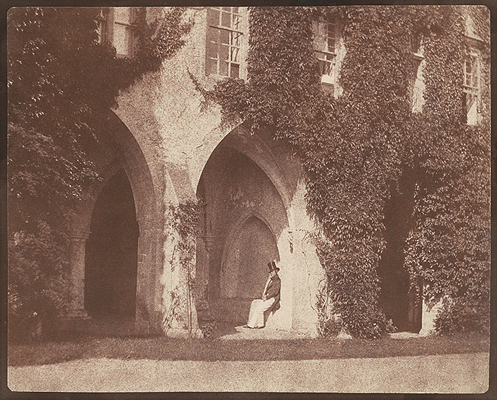 William Henry Fox Talbot, The Reverend Calvert Jones in the Cloisters at Lacock Abbey, 1845, salted paper print, National Gallery of Art, Washington, Promised Gift of Robert B. Menschel