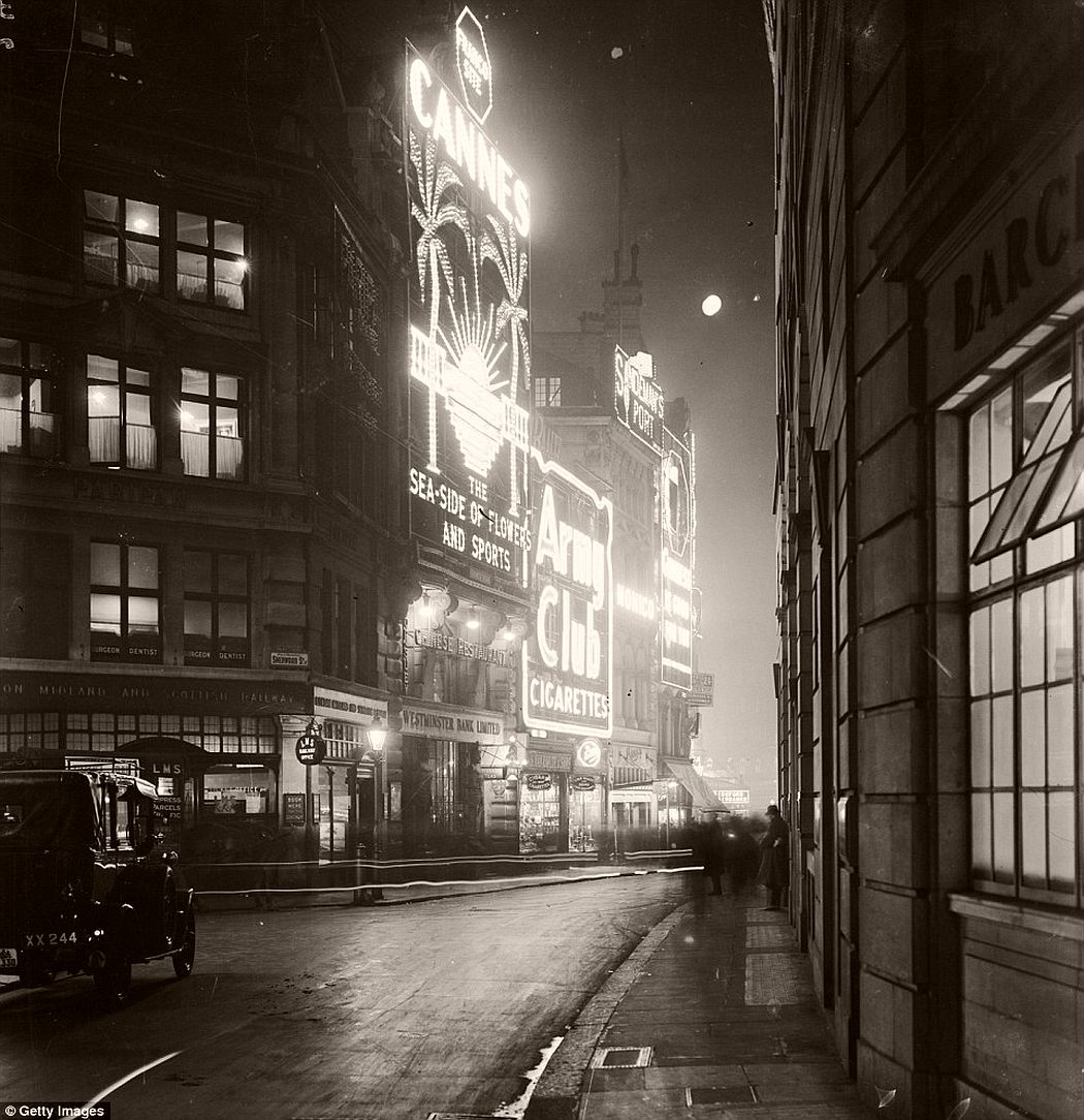 The lights of Piccadilly Circus, just around the corner, London, 1928.
