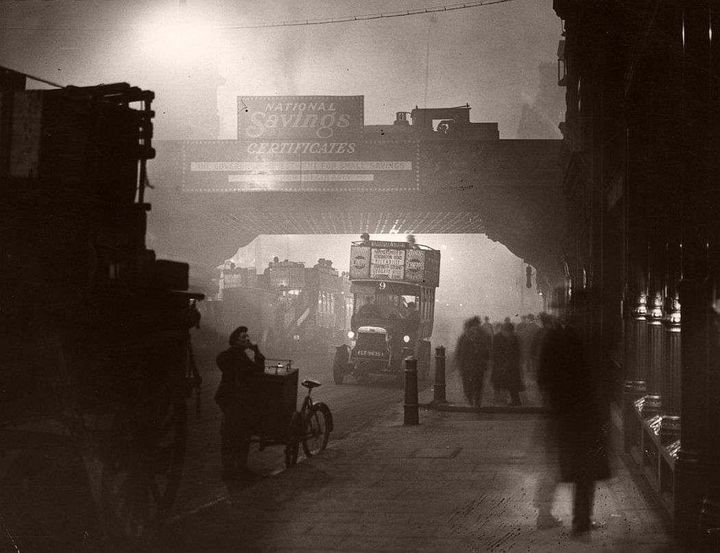 Fog encases workers at Ludgate Circus, London, November 1922. It was reported that Londoners compared the effects of winter fogs to being blind as they could often only see a few yards ahead.