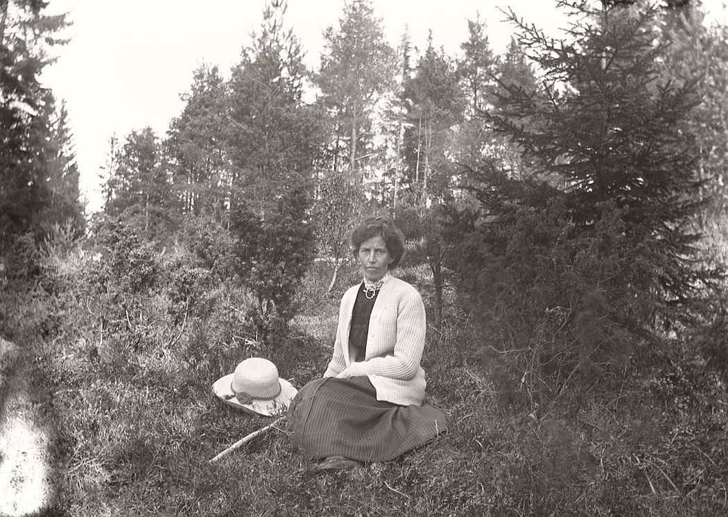Woman sitting in the woods.