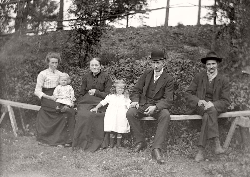 Family gathered on the bench.