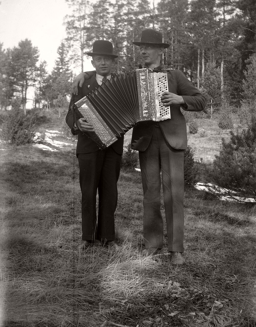Two men with an accordion.