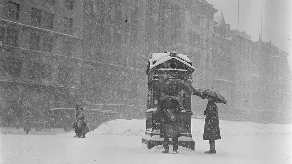 Circa 1923. People looking at the weather instruments on Common in snow.