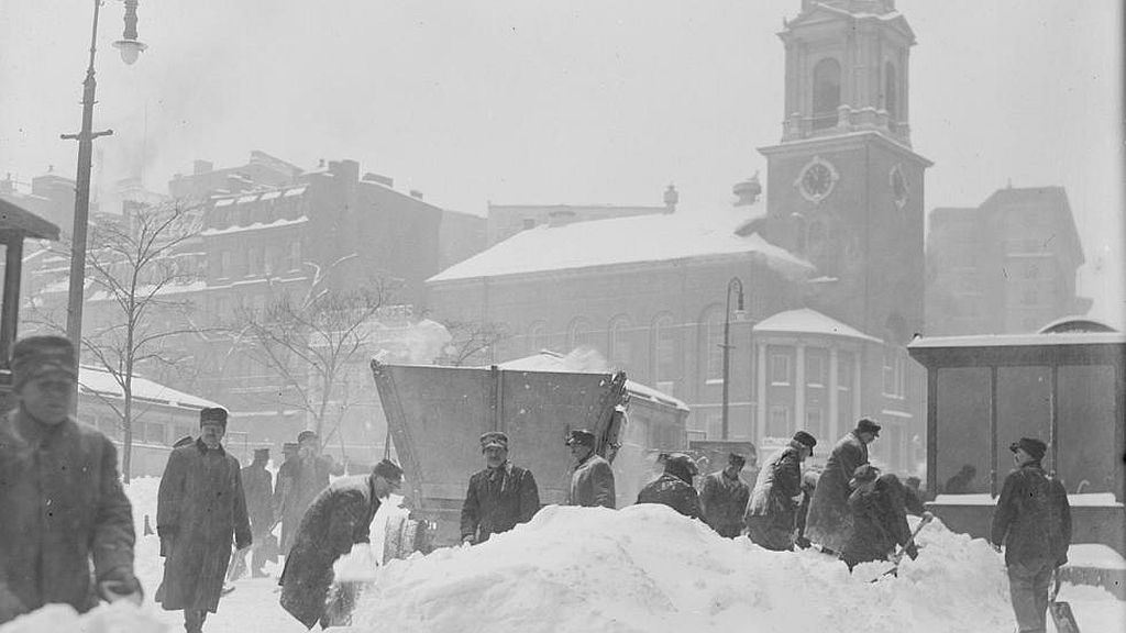 Circa 1916. Severe snowstorm reaches Boston, clearing snow at corner of Park and Tremont St.