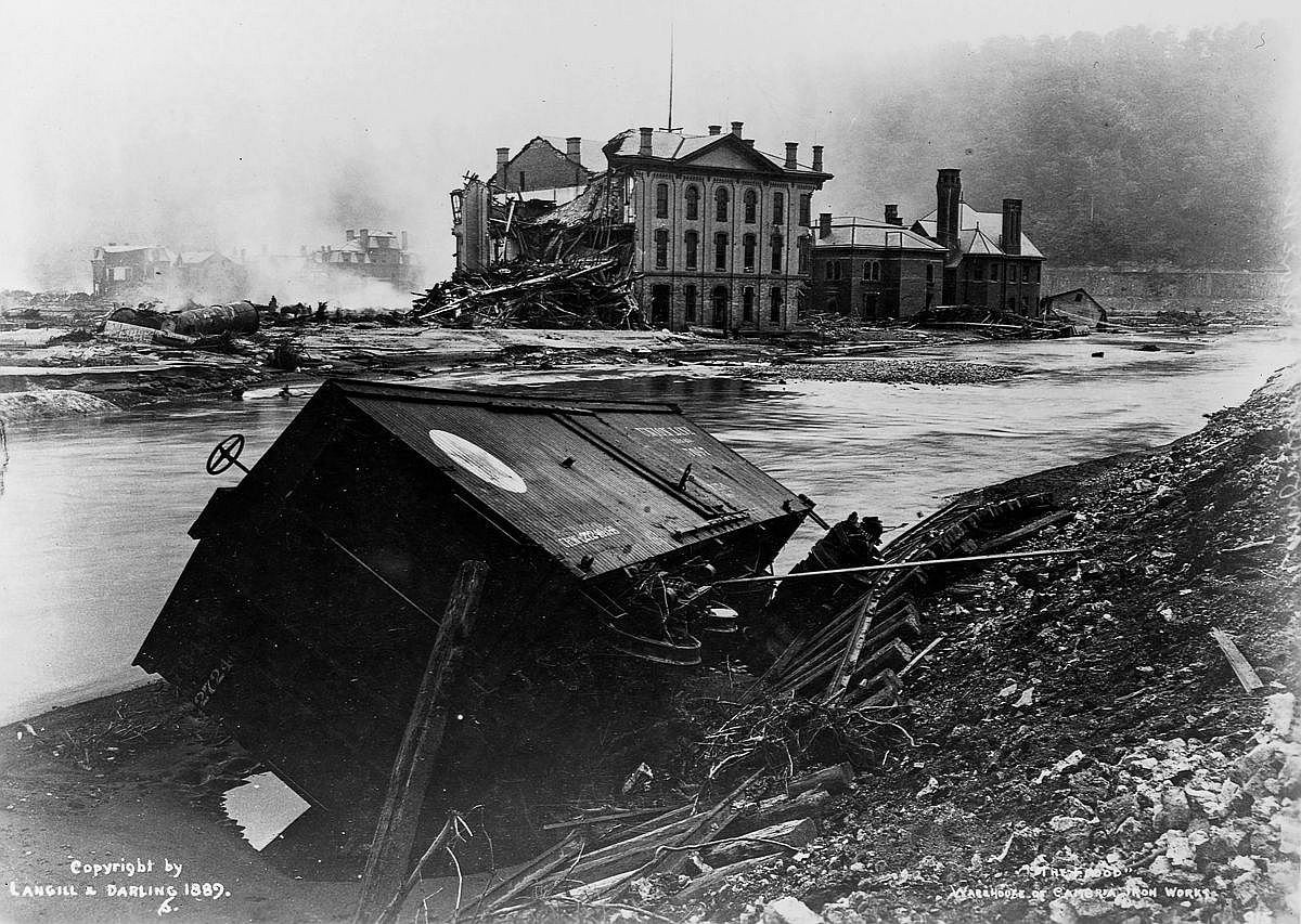 A freight car lies near the damaged Cambria Iron Works warehouse.  Image: Library of Congress/Corbis/VCG via Getty Images
