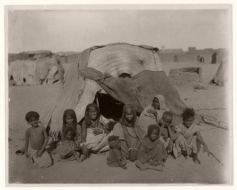 A group of Bisharin before their tent at Wady Halfa, Egypt