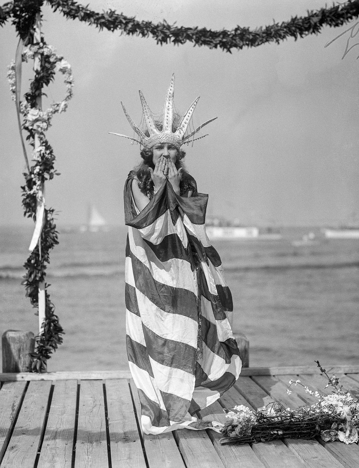 Sept. 7, 1922 - Margaret Gorman, the newly crowned Miss America, awaits the arrival of Neptune in her royal robes at the opening of the Atlantic City Beauty Pageant.