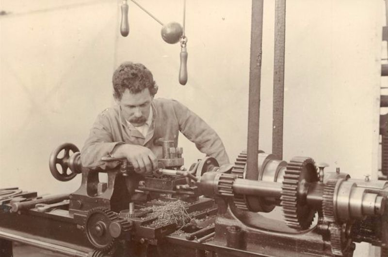 Bill Courtney at his lathe in the Molton Street works, c1905