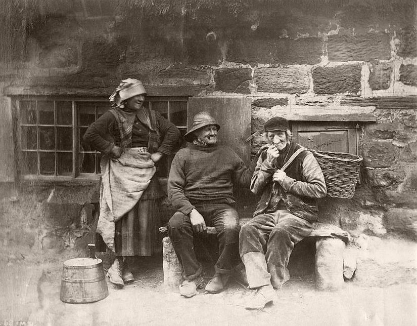 Portrait of three people outside a house