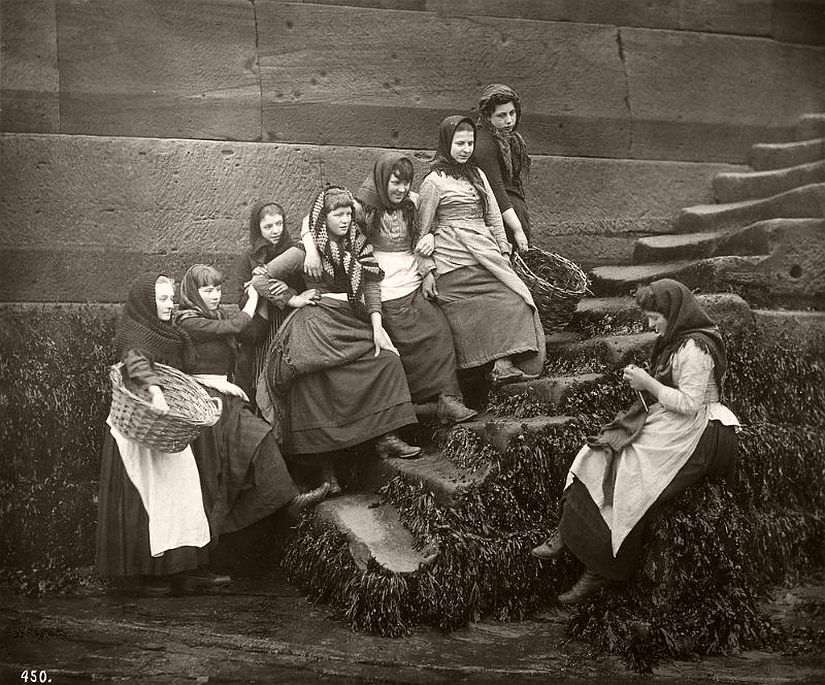 A group of fishing girls in the stairs down to the beach, Whitby