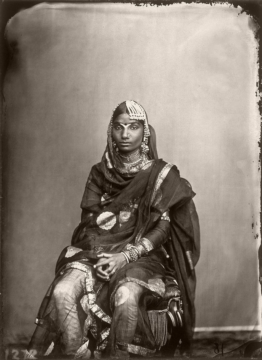 Portrait of a woman in the harem of the royal palace of Jaipur, India, 1857–1865. (Photo by Maharaja Ram Singh III/Alinari via Getty Images)