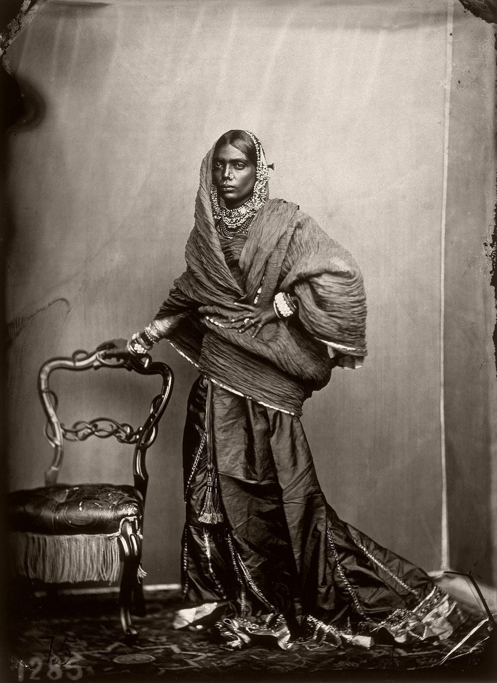 Full portrait of a woman in the harem in the royal palace of Jaipur, India, 1857–1865. (Photo by Maharaja Ram Singh III/Alinari via Getty Images)