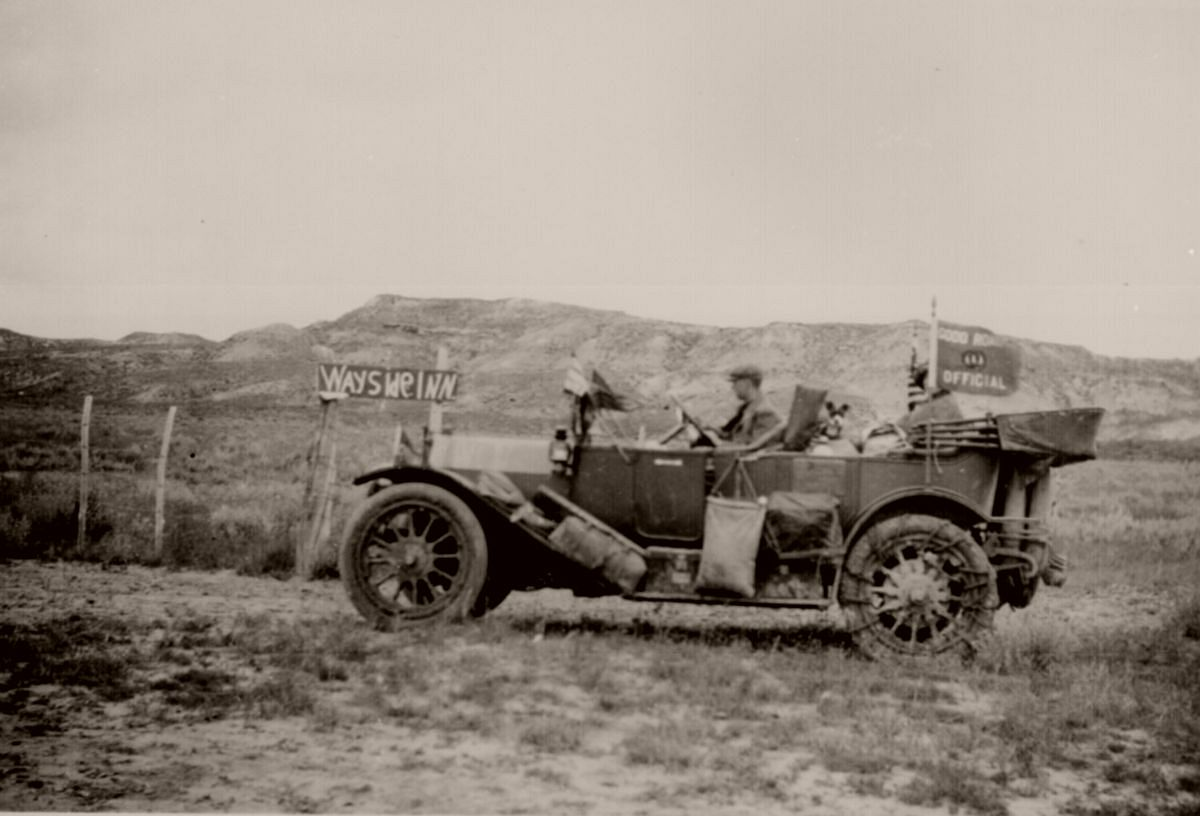 An AAA Good Roads Official on his transcontinental auto trip passes the only road sign in evidence along the dusty, desolate road near Glendive, Mont. July 1912.