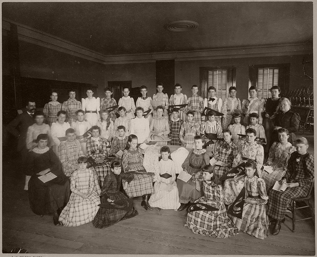 Posed view of school girls in a classroom