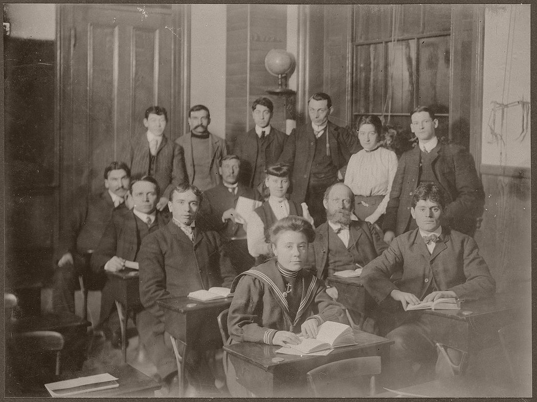A group of 14 students in a classroom