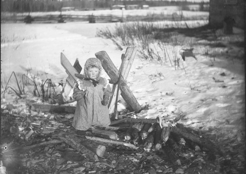 Unidentified Brebner child dressed warmly for winter