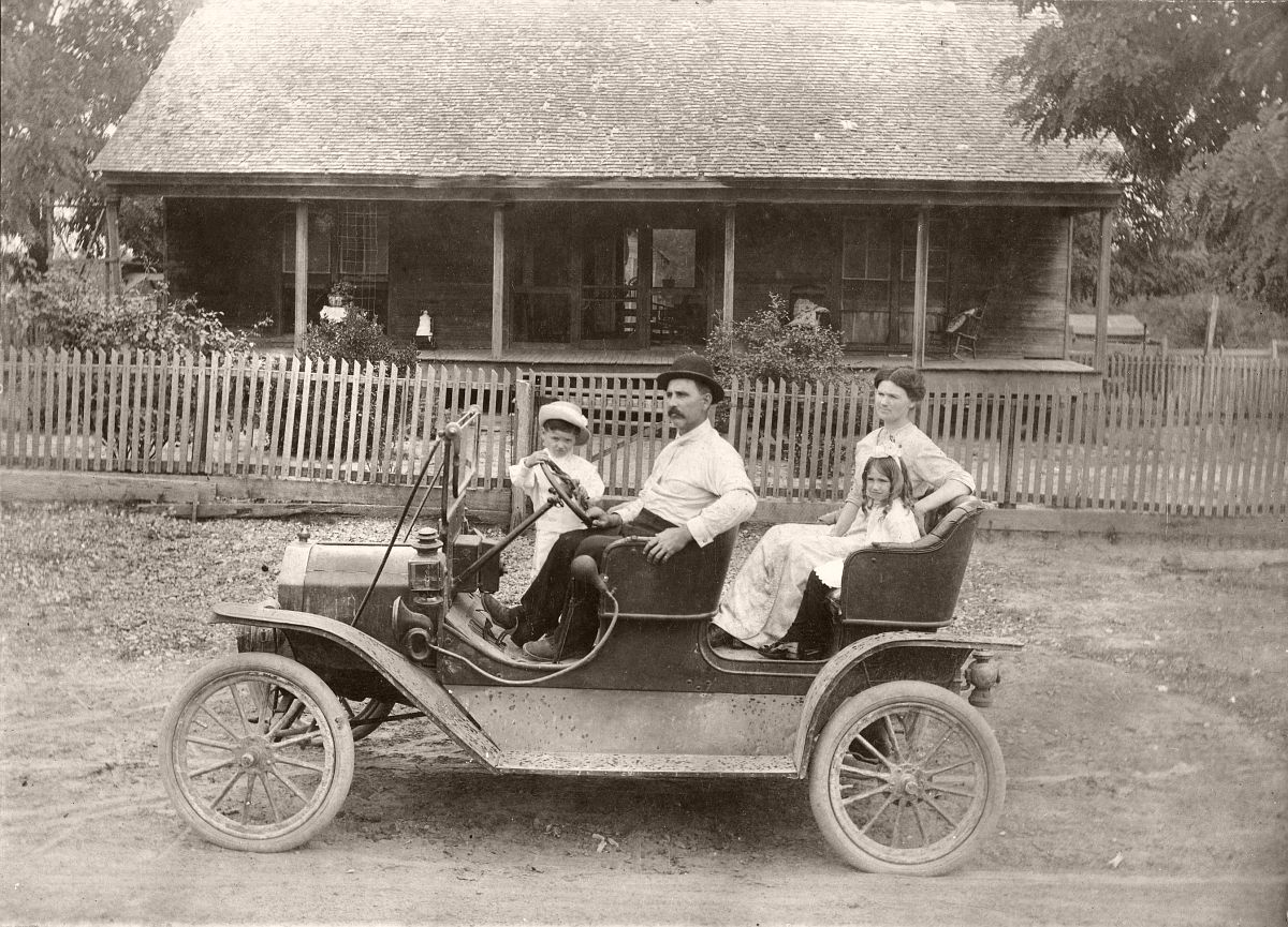 Unidentified family in a Ford Model T Tourabout, c1910