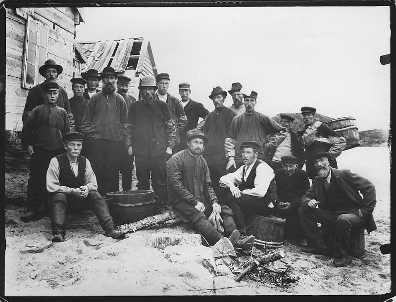 Group portrait of men on the beach