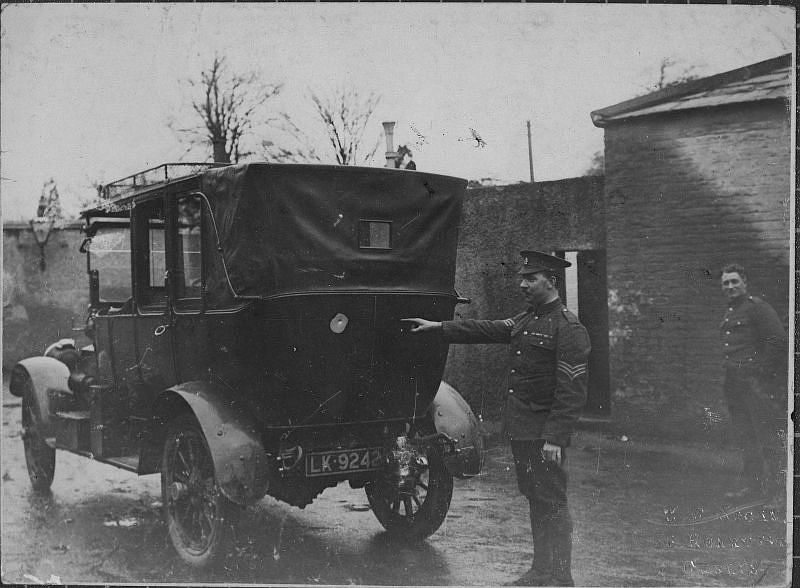 The car in which Lord French was ambushed, sergeant pointing out bullet hole, Dublin, December 1919
