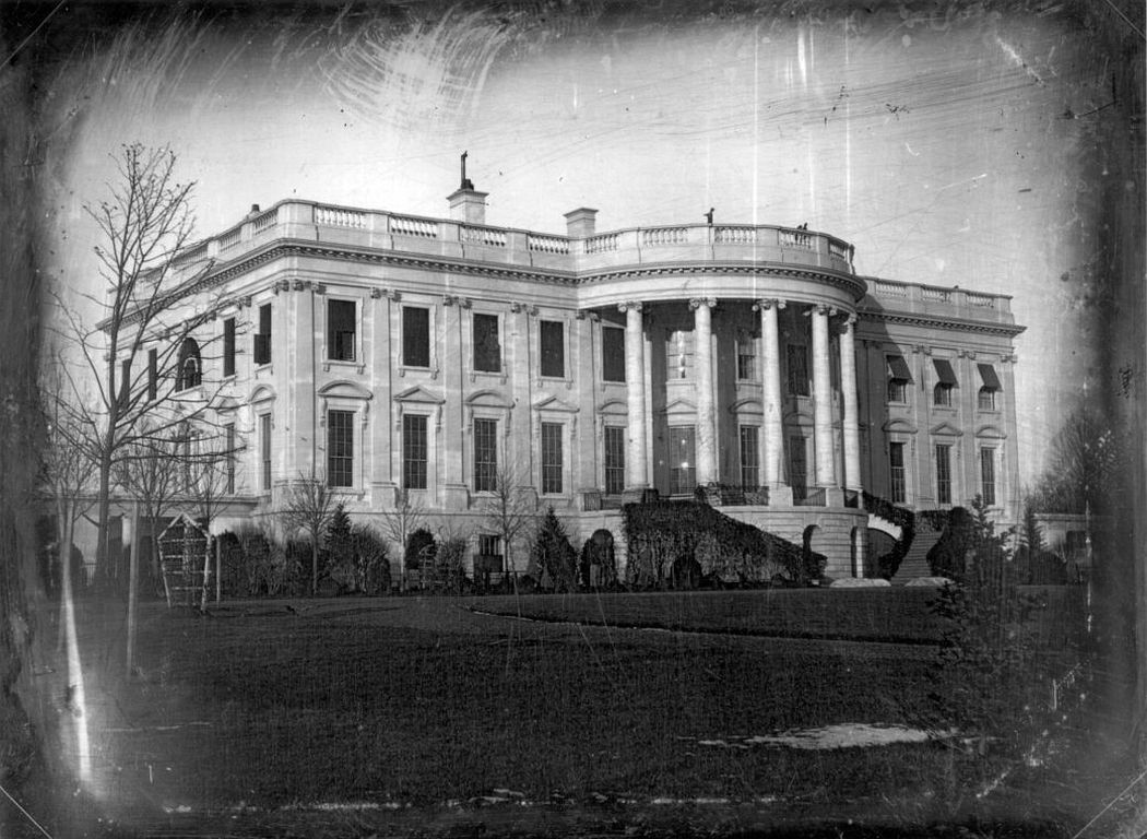 South view of the President's House looking north and east: earliest known photograph of the White House, c. January 1846, President Polk's first year in office. The cast of the shadows indicates that the photograph was taken in early morning light. Notice the barren trees, the patch of snow in the foreground and the piles of snow at the base of the staircase. (Image: John Plumbe, Jr./Library of Congress, via White House Historical Association)