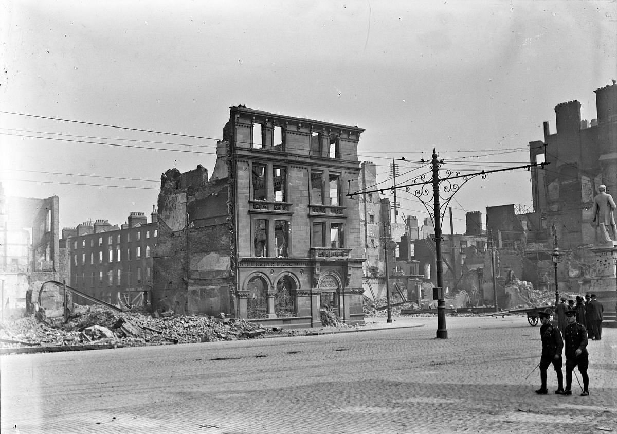 Abbey Street corner, Hibernian Bank shelled. The Hibernian Bank facade on the corner of Abbey St. and O'Connell street stands in the midst of the destruction wrought during the Rising!