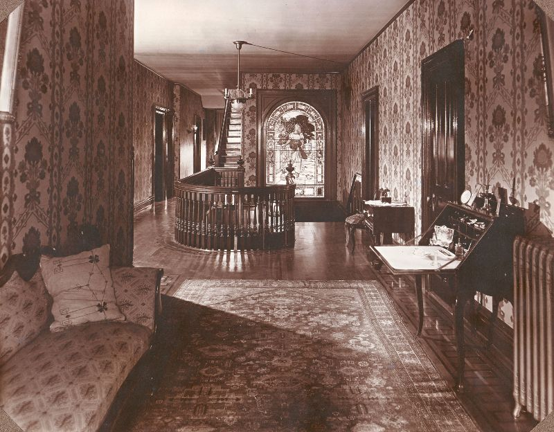The upstairs hallway at 'Ivyhurst.' The stained glass window in the background was saved and is on display at the Waynesburg University Paul R. Stewart Museum