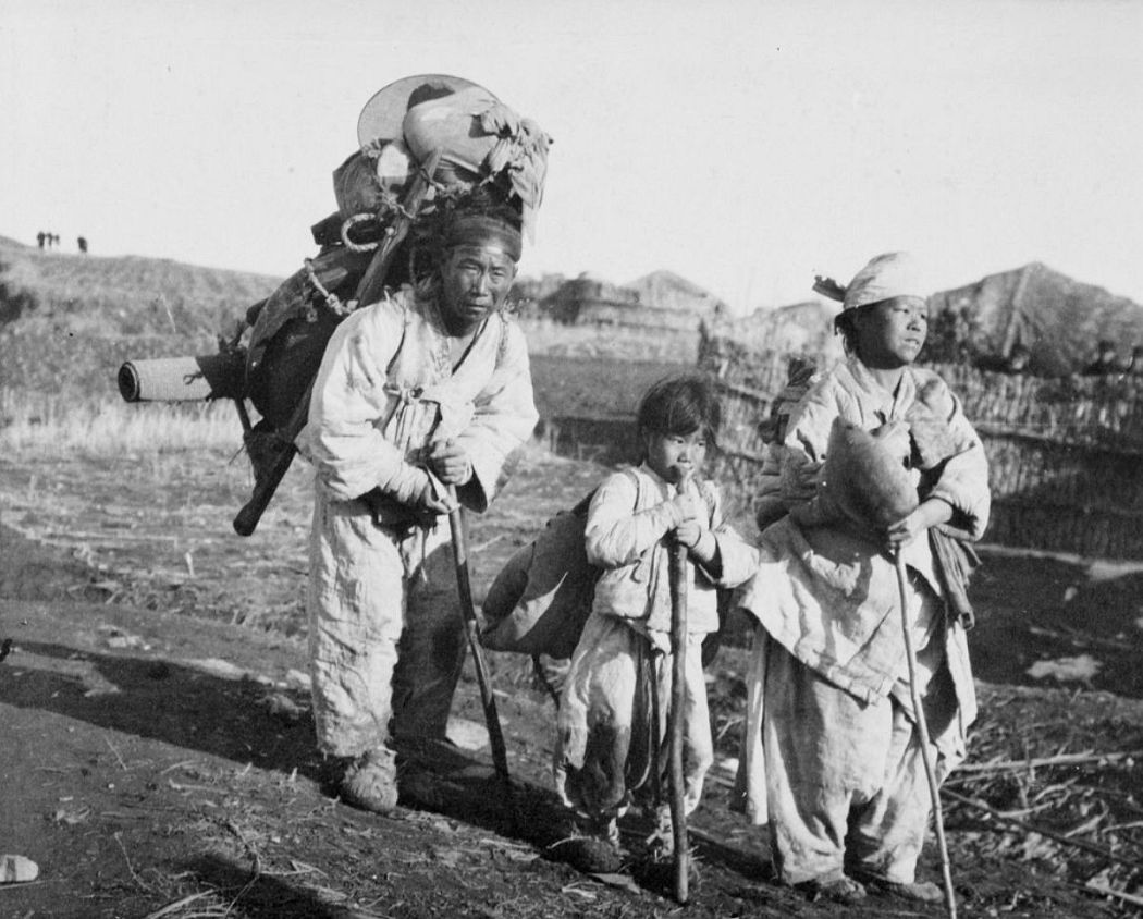 A small family of Korean refugees fleeing the Japanese Army. Korea.,1904.