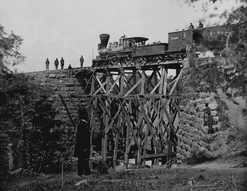 "The engine ""Firefly"" on a trestle of the Orange and Alexandria Railroad, circa 1864."