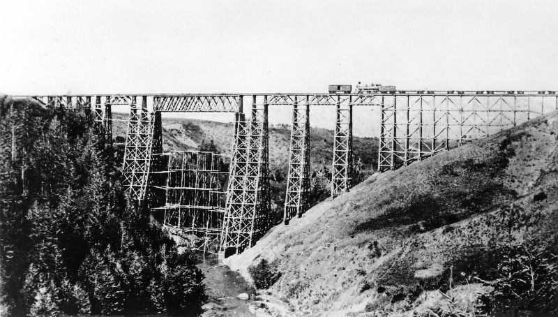 Montana's massive 214 foot high Two Medicine Creek timber trestle on the Great Northern Railway.