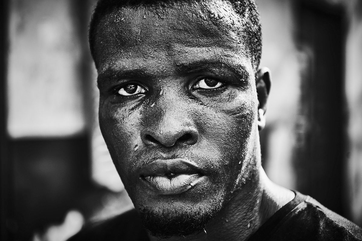 "Boxer Obodai Sai poses for a portrait after a training session at ""Attoh Quarshie Boxing Gym"" in Accra, Ghana, on September 28th 2017."